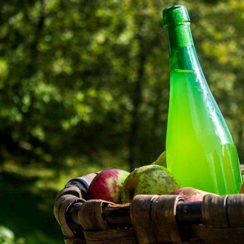 Cider bottle in basket of apples (1)