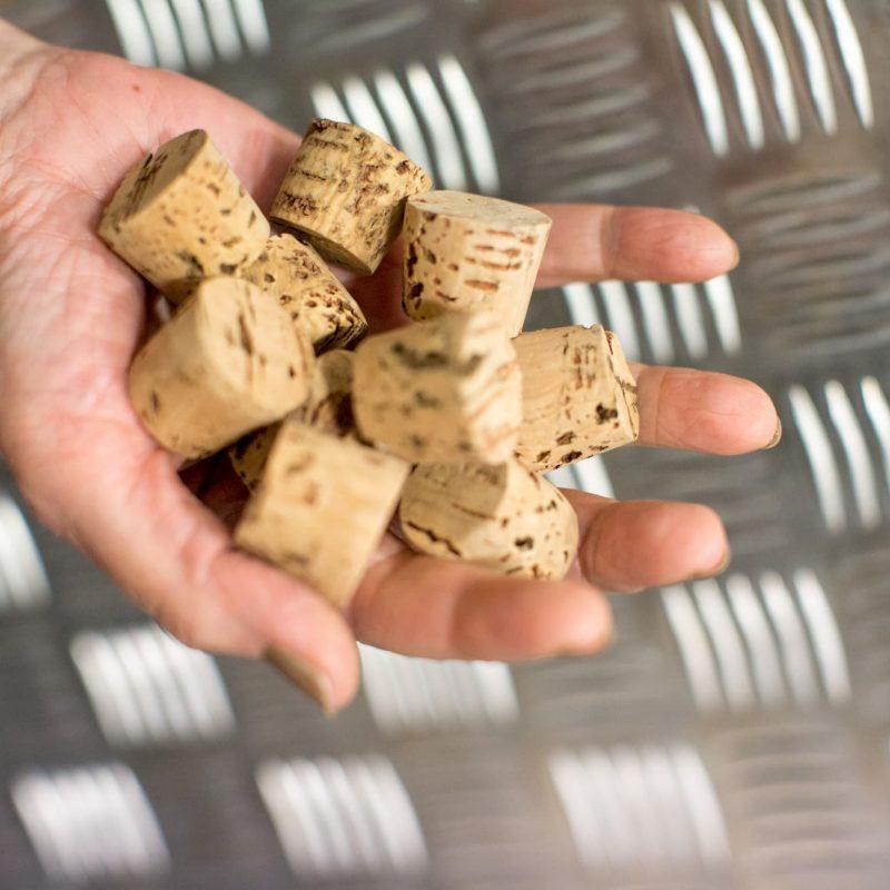 Hand holding corks